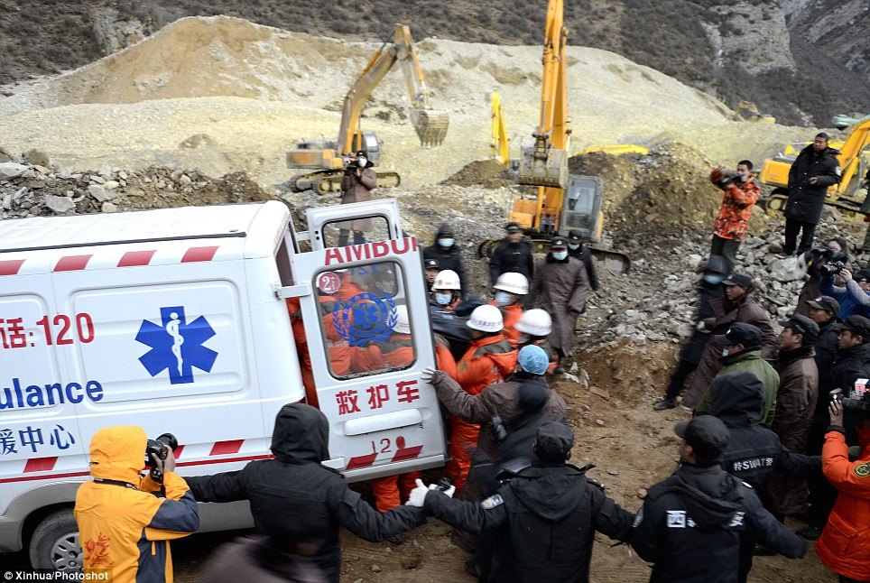 Struggle: Two bodies have been found after more than 36 hours since the incident, but rescuers are trying to locate the other 81 mine workers trapped