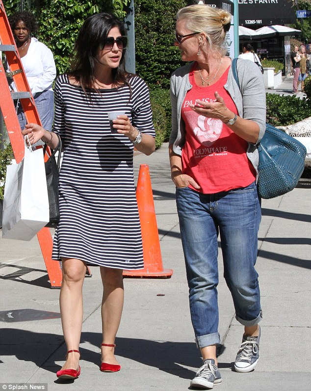 Goodies for her baby: The actress left with her leftovers in her hand, perhaps to take home to Arthur