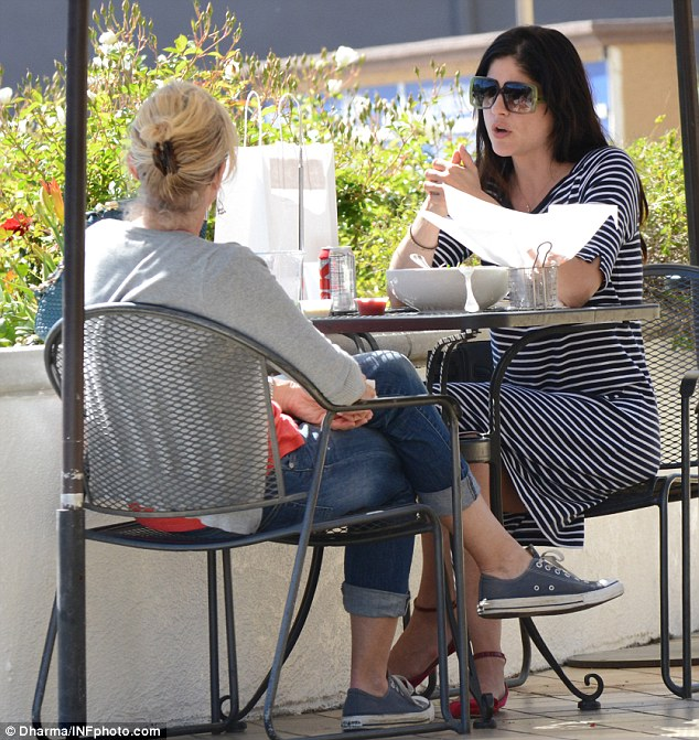 Chatty: The pair had a very animated conversation over a light lunch of salad and chips