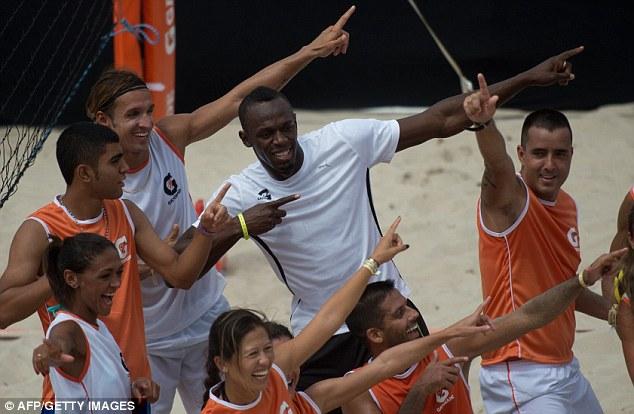 Iconic: Bolt performs his famous celebration