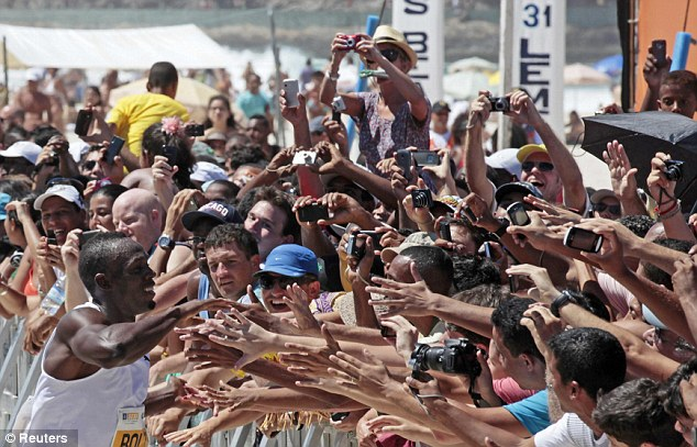 Adoring: Crowds of spectators lined up on the beach to see the superstar up close