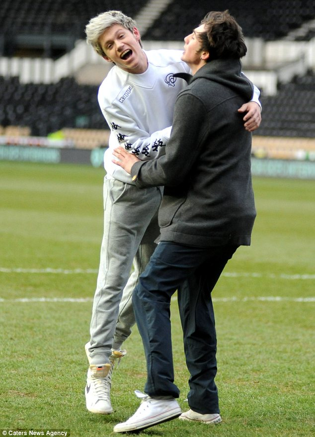 Celebrate: Niall was seen hugging his friend and jumping into the air after scoring a goal