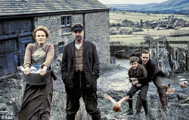 Maxine Peake and John Simm, second left, star in The Village, which debuted last night amid criticism from viewers