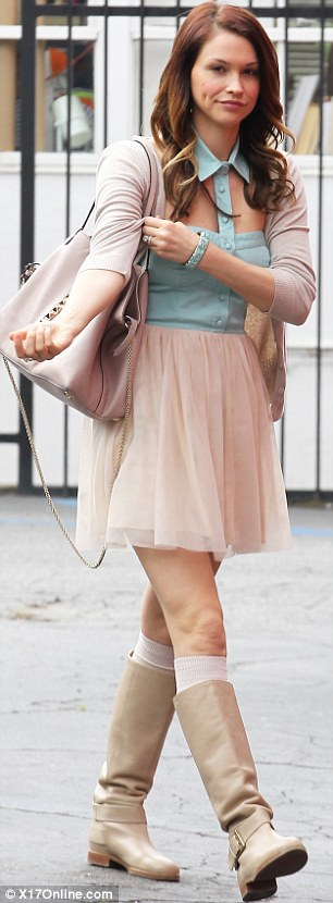 Quirky: Lisa opted for a slightly mismatched ensemble featuring a tutu and cowboy boots