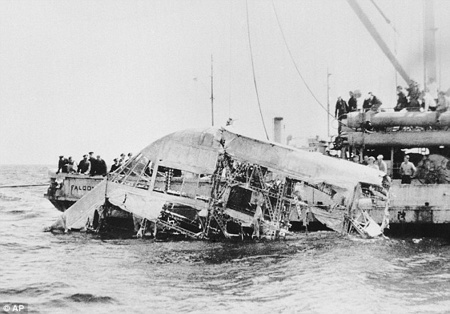 Horrific: Crews pull the wreckage of the USS Akron from the sea off the coast of New Jersey after it crashed in a storm on April 4, 1933