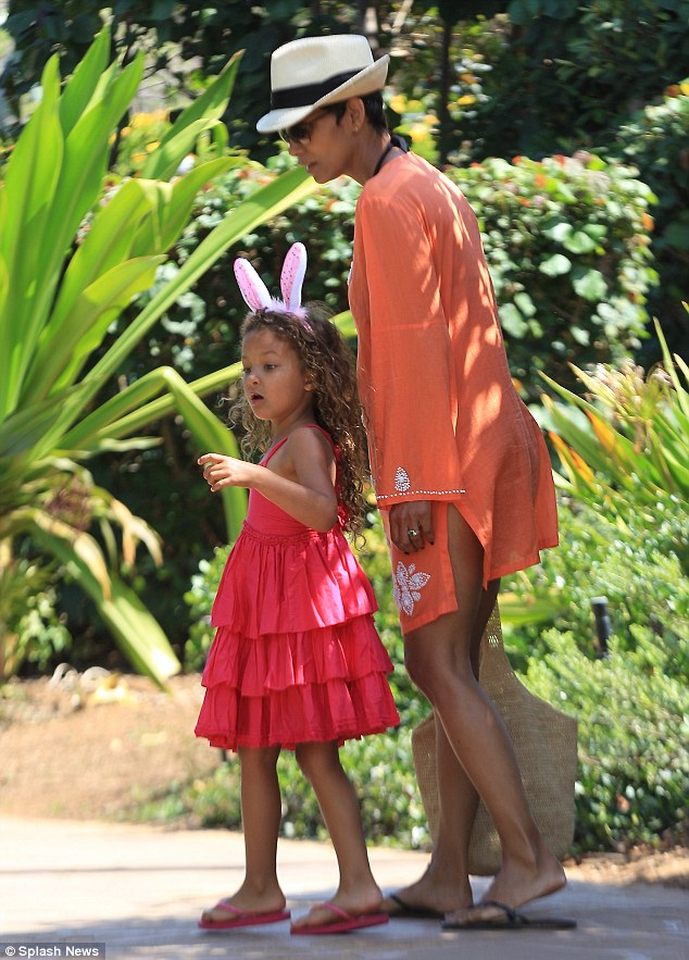 Hopping around: Halle Berry's four-year-old Nahla bounced about in a pair of rabbit ears as the pair walked through the Hawaiian wilderness on Sunday