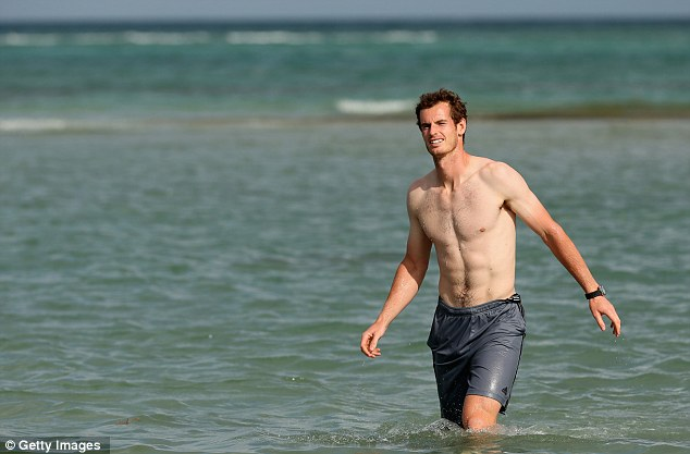 Wading: Murray walks in the ocean after his three set victory against David Ferrer