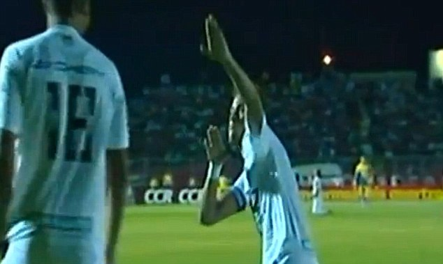 In honour: Neymar pays tribute to Usain Bolt after scoring for Santos on Sunday