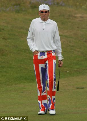 Country colours: Poulter wearing the infamous Union Jack trousers at the Open Golf Championship at Royal Troon in 2004