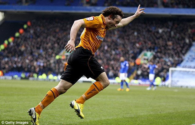 Opener: Stephen Hunt wheels away in celebration after finding the net from inside the six-yard box