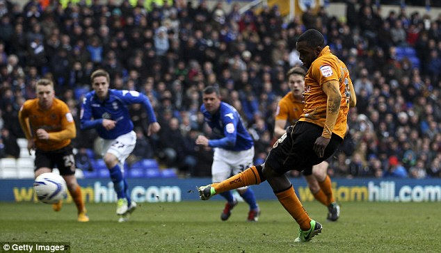 Slotted: Kevin Doyle was taken down by Birmingham keeper Jack Butland before Ebanks-Blake put it away