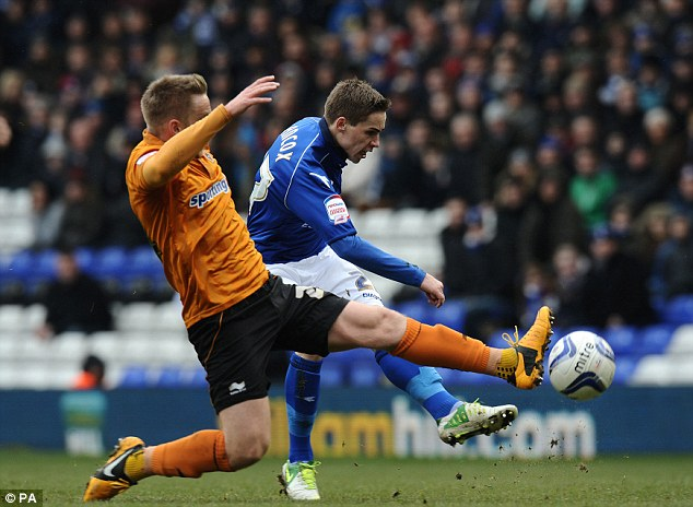 Fired: Birmingham City's Mitch Hancox rifles a shot at goal as the home side try to strike back
