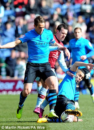 Tangle: Burnley's Ross Wallace battles with Chris Cohen (left) and McGugan