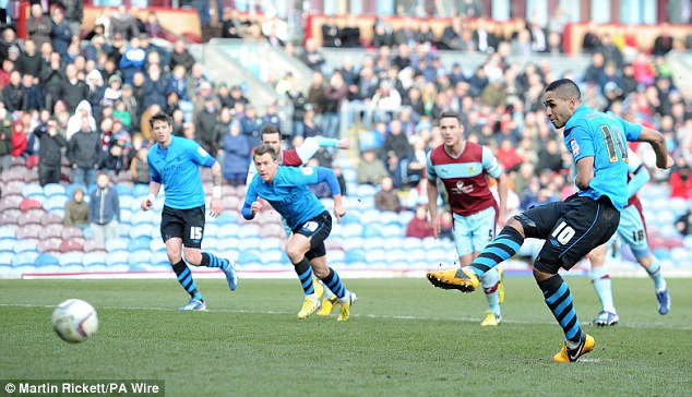 At the death: Lewis McGugan scored a late penalty to rescue a point for Nottingham Forest in dramatic style