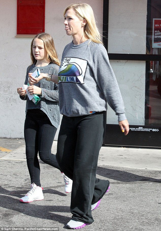 Pared back: It seems that Jennie is quite comfortable around her beau, as the 40-year-old star went make-up free for the outing and dressed down in a pair of baggy tracksuit pants, a sweat shirt and some trainers