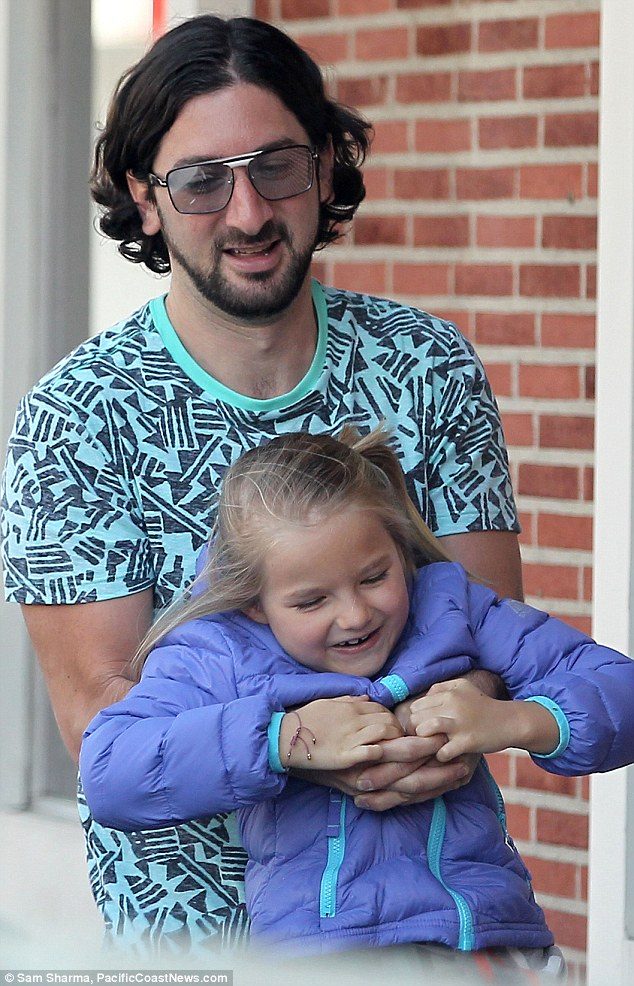 Doting: The Big Gigantic rocker was seen doting over the Beverly Hills 90210 star's youngest daughter Fiona during the outing