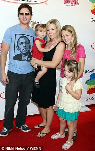 Moving on: It appears that Jennie is moving on from her split with husband Peter Facinelli, whom she and her daughters are pictured here with in 2008