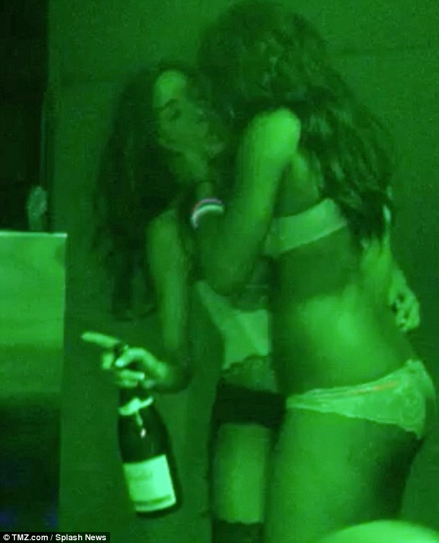 Party girl: Images were recently released of the 21-year-old mother of one partying with nothing but lingerie on while kissing another woman