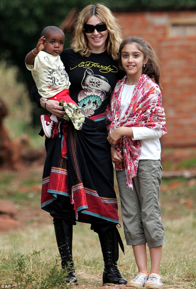 Looking for a sibling: Madonna with David and eldest daughter Lourdes in Malawi in April 2007 - before she adopted Mercy