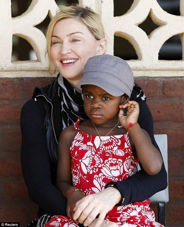 Back to Malawi: Madonna and her daughter Mercy on a previous visit to Gumulira village in Malawi in April 2010