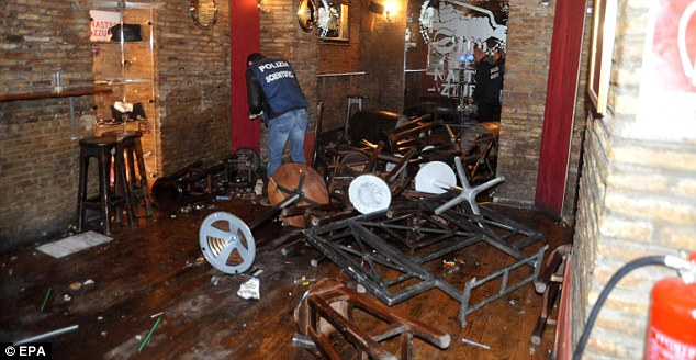 Carnage: Tottenham fans were attacked in Rome before their Europa League clash with Lazio