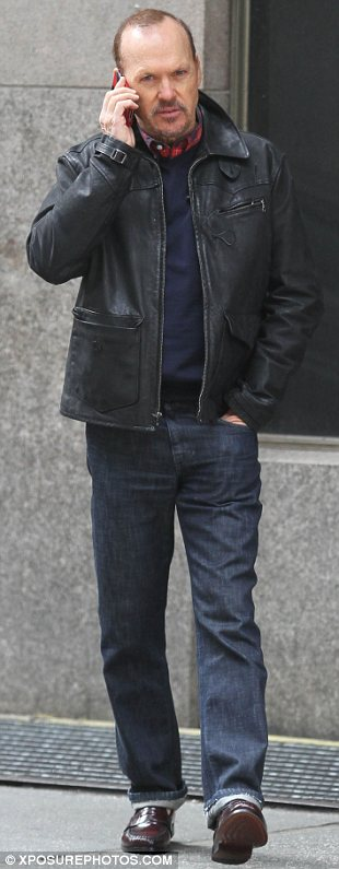 Younger than his years: The 61-year old looks great for his age as he walks the Midtown Manhattan set