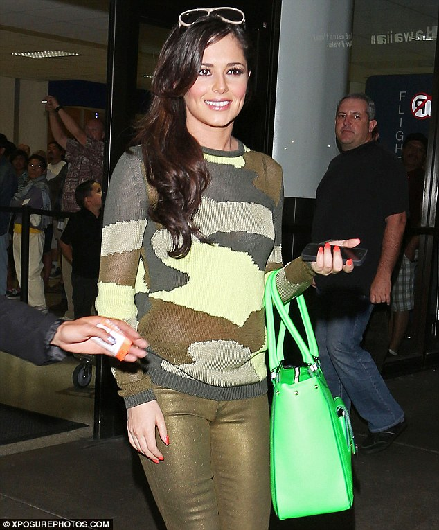 There's no hiding in that outfit! Cheryl Cole stood out in a camouflage jumper, skintight gold trousers and a neon bag as she touched down in Los Angeles recently