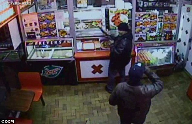 CCTV footage shows the thieves brazenly walking into the near empty KFC joint at 11pm last Thursday brandishing a shotgun