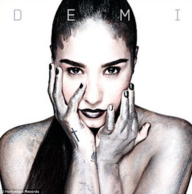 Daring: Demi Lovato posed topless for her new self-titled album cover
