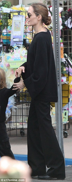 Walk on by: Angelina was a picture of cool in her all black outfit with matching sunglasses