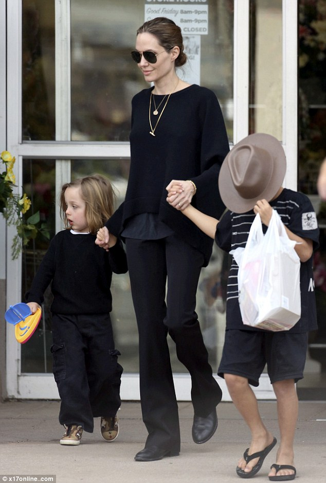 Walk this way: Angelina looked calm and relaxed as she and her boys left the arts and craft shop