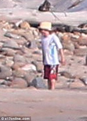Smart choice: Six year-old Shiloh stayed sun-safe by wearing a hat on the beach