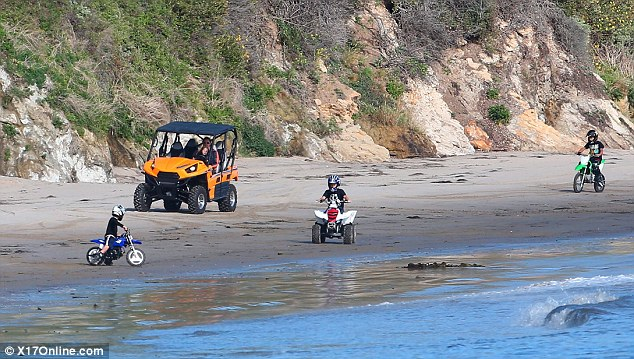 Stay close: The two brothers took their motocross bikes for a ride as Brad and Knox chose the slightly more comfortable choice of transportation