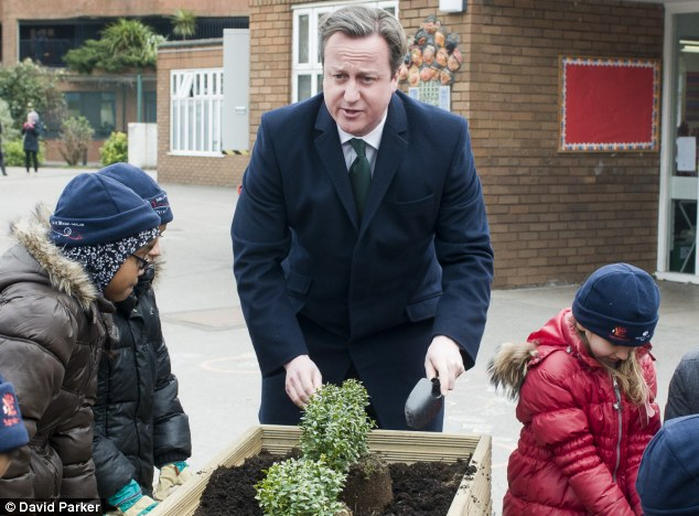 Mucking in: David Cameron, pictured getting his hands dirty planting trees last week, described how he jumped into the swamp to save the sheep's life