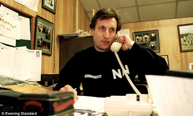 Call on me: Warnock answers the phone during his tenure in charge of Notts County in 1991