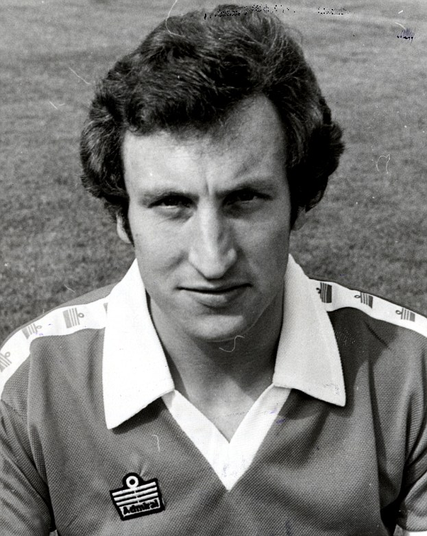 Golden years: Warnock donning the Barnsley shirt in his playing days