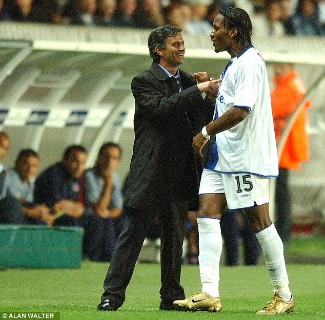 Golden boy: Mourinho and Drogba celebrate after a 3-0 Champions League win at Paris Saint-Germain in 2004 where the Ivorian scored two goals