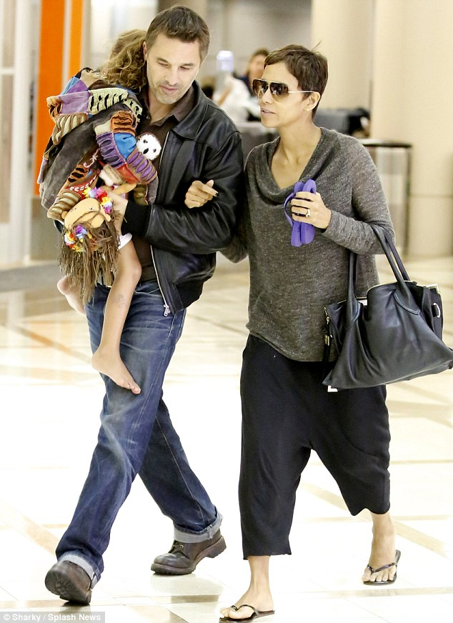 Fracas: Olivier Martinez allegedly assaulted a photographer on Monday night after touching down in Los Angeles with fiancee Halle Berry and her daughter Nahla following a trip to Hawaii