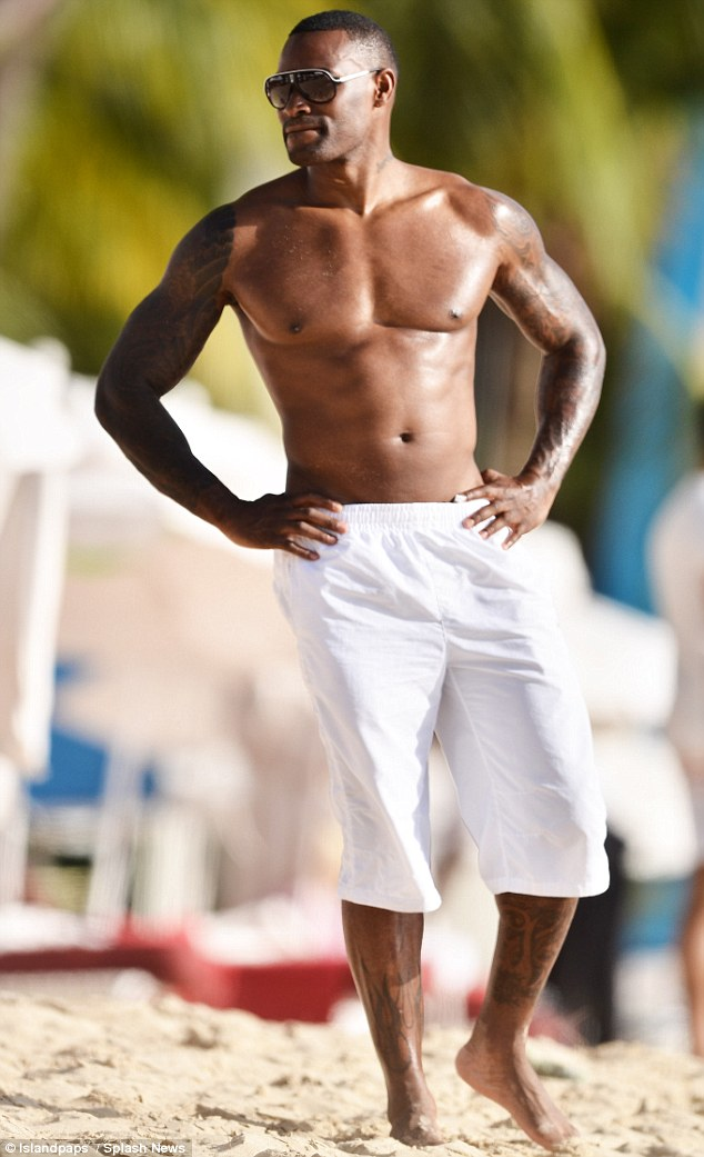 Baking in Barbados: Wearing just a pair of white boardshorts and some shades, Tyson looked like he was on set of his very own modelling campaign as he posed and preened on the sand