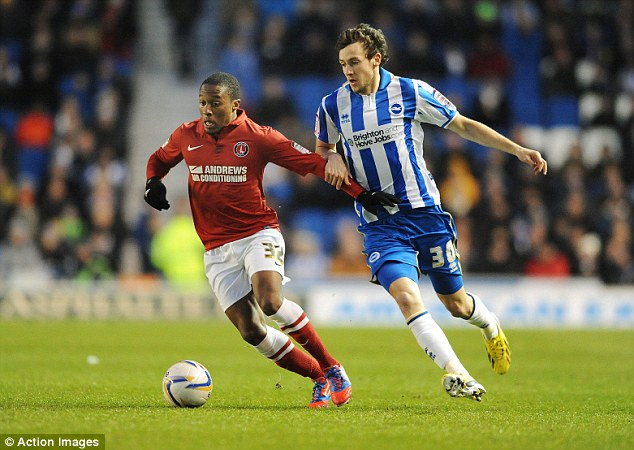 Draw: Brighton's Will Buckley and Charlton's Callum Harriott in action on Tuesday night