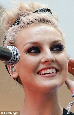 Ouch! Perrie has a new piercing on her nose as well as the neck addition