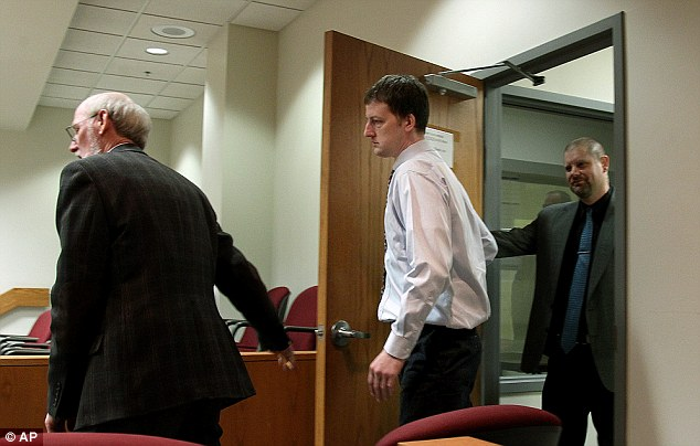 Aaron Schaffhausen, (center), follows his attorney John Kucinski, left, Court - Schaffhausen is accused of killing his three daughters on July 10 in River Falls