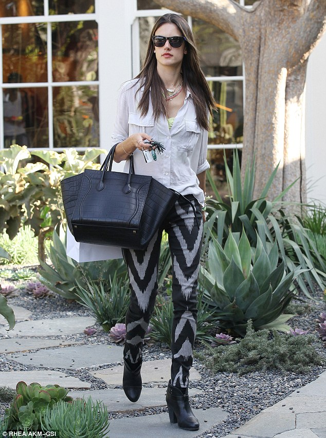 Shopping score: The shopping trip appeared to be a success as Alessandra was seen carrying a large white bag as she made her way to her car