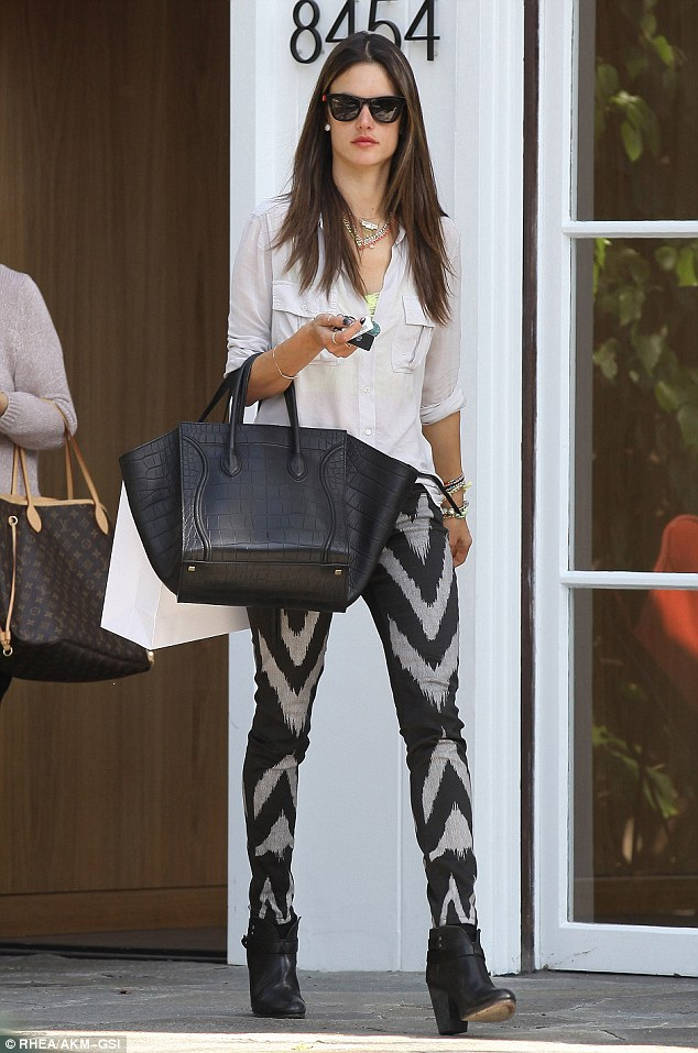 Flair for fashion: Alessandra Ambrosio showed off her curves in flashy black-and-white patterned trousers as she left the Isabel Marant store in West Hollywood, Los Angeles on Tuesday
