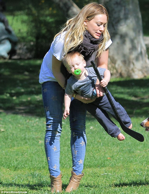 Just like daddy! Hilary Duff's son Luca played hockey as the two enjoyed a day at Coldwater Canyon Park in Beverly Hills, California on Tuesday