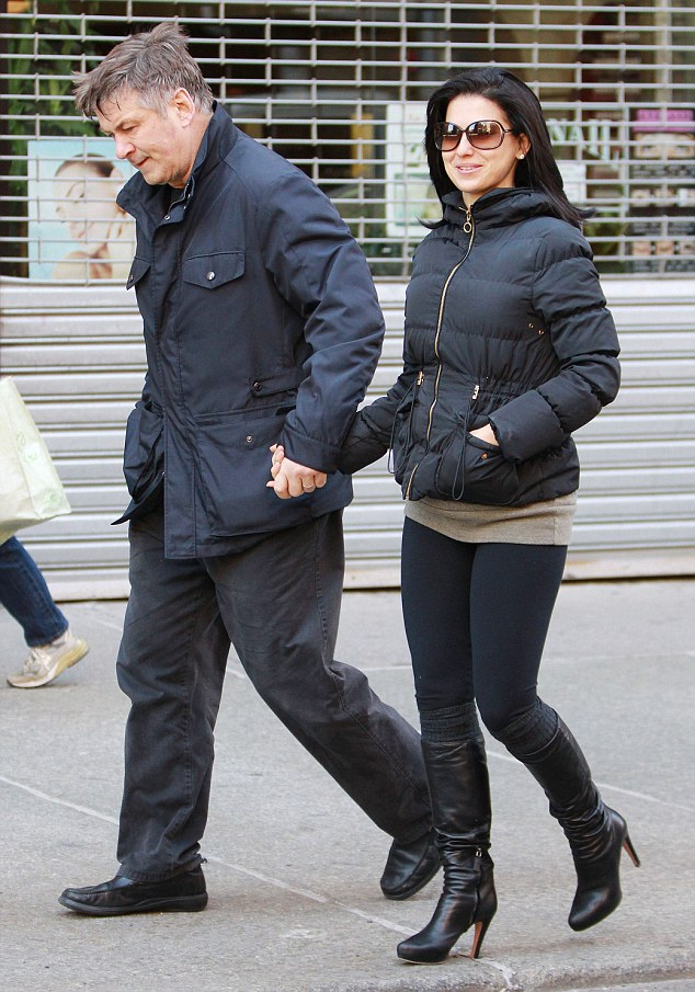 Proud husband: Baldwin eagerly clutched his wife's hand during their mid-morning trek to New York's Grey Dog cafe in the downtown neighbourhood of Greenwich Village