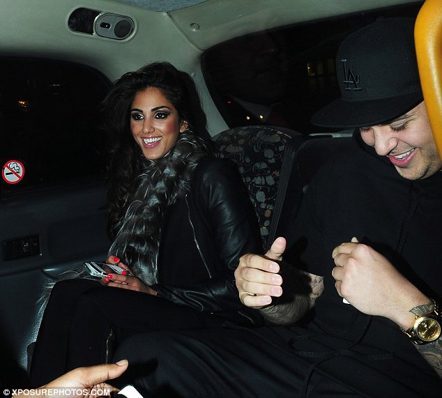 Having a great time: The pair were seen in the back of a cab together laughing