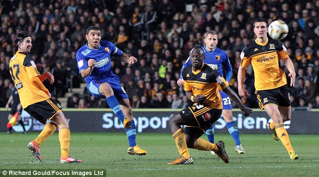 Strike: Troy Deeney scores the winner at the KC Stadium