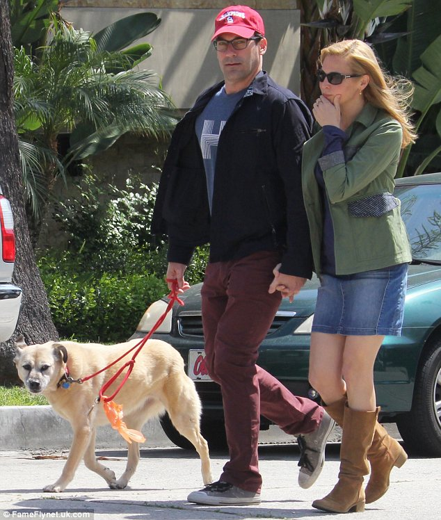 Fun in the sun: The trio appeared to be enjoying the warm weather during the leisurely sunshine-filled stroll