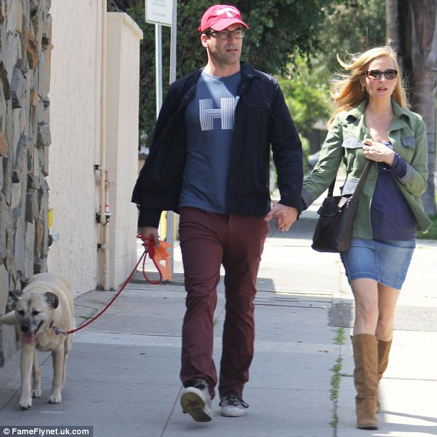 Keeping it casual: Jon and his long-time girlfriend were both dressed down for the outing